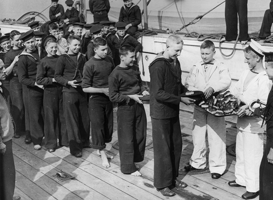 Young sailors receiving naval training awards on board a ship