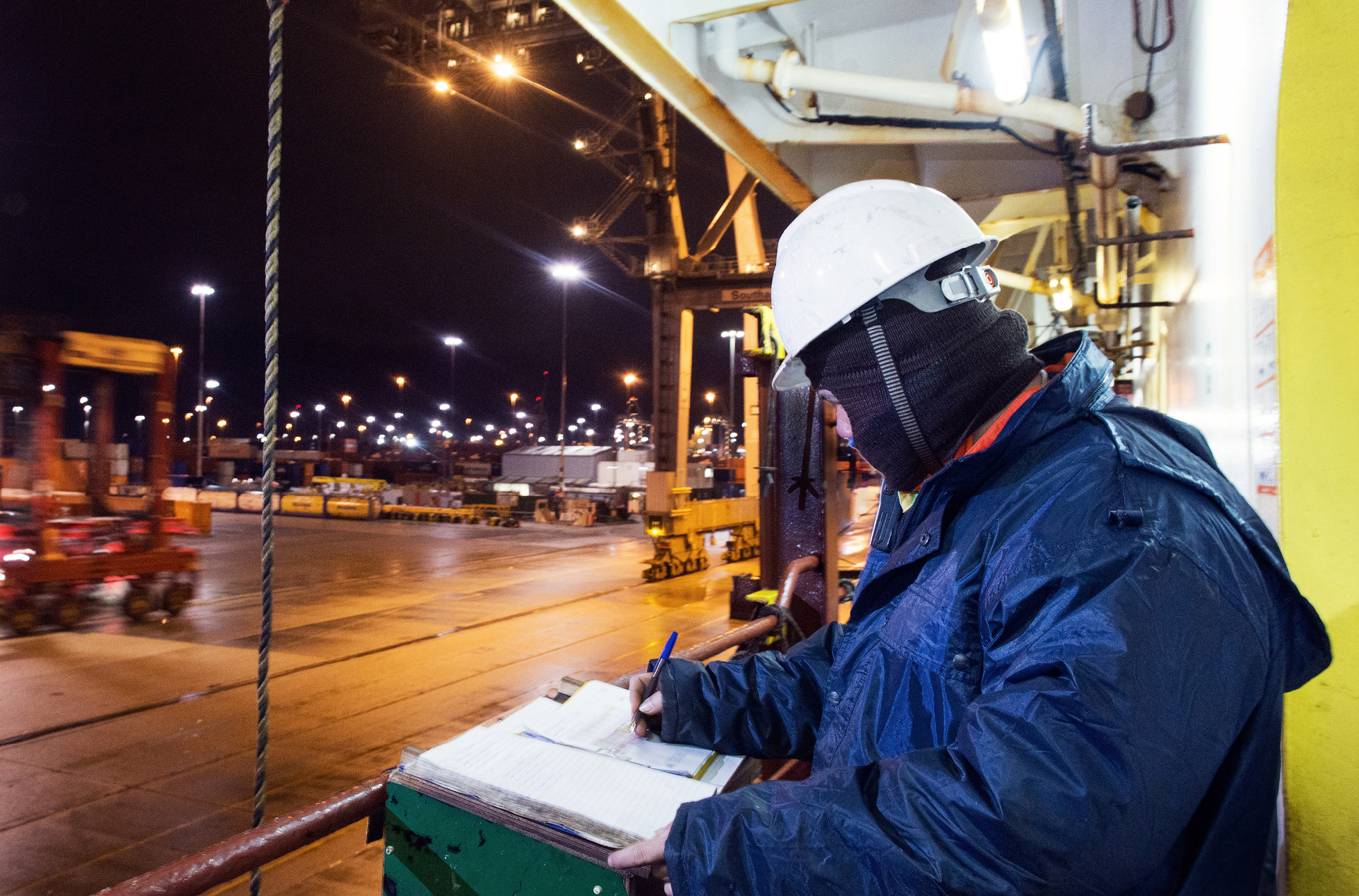 Workman completing paperwork on the job at night